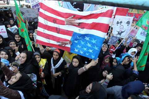 Iranians desecrate US flag